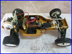 2x vintage Associated RC10 Gold pan cars withFutaba radio spare parts, chargers