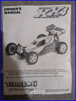 Vintage Team Losi XX4 with Futaba Radio, Novak ESC, Manual, & extra parts